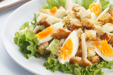 Caesar salad with eggs, lettuce, croutons, parmesan, and chicken