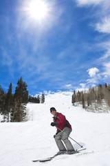 Male Skier laughing while enjoying his ski vacation