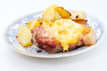 Grilled steak meat with cheese sauce and potatoes