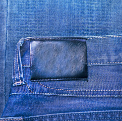 Black leather label isolated over denim texture