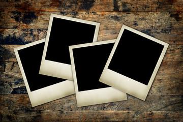 blank instant photos frames on a wood