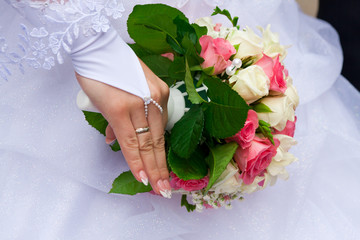 Bride's hand holding the bouquet