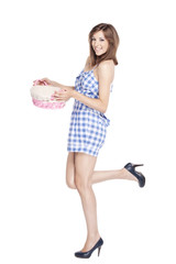 Girl holding a basket on white background