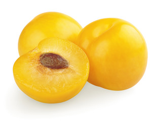 Yellow plums with half on white