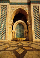 Ornate fountain and geometric patterns outside of a mosque