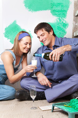 Smiling couple having champagne
