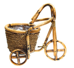 Flower pot in the form of a cart on a white