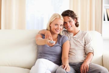 Smiling couple watching TV