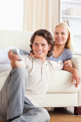 Portrait of a cute couple watching the television