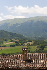 Sarnano (Marches, Italy) - Landscape over a tiled roof