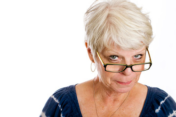 Mature woman looking over her glasses