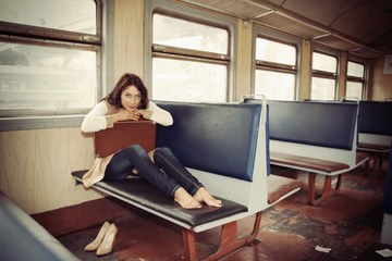 girl sitting  of a train