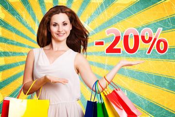 junge Frau zeigt -20% Angebot
