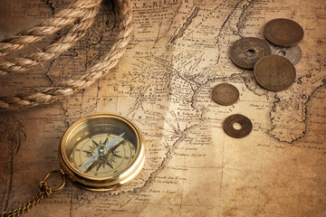 Wall Mural - old compass, old coins and rope on vintage map