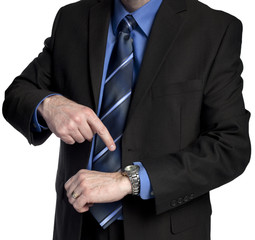 businessman is pointing at his watch