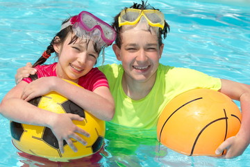 Happy young children in pool