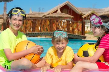 Happy siblings in the pool