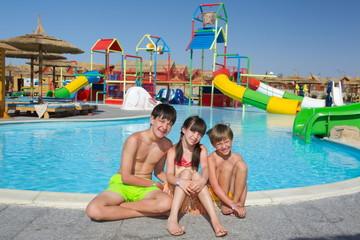 Happy children by pool