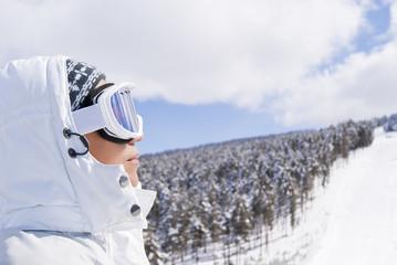 Portrait of beautiful skier looking forward