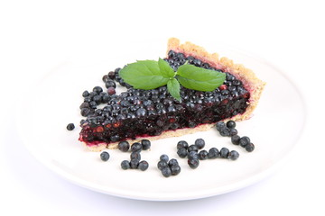Blueberry Tart: a portion on a plate decorated with mint