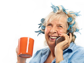 Laughing Lady on Cell Phone with Coffee Cup