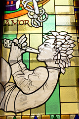 Stained glass with lying piper