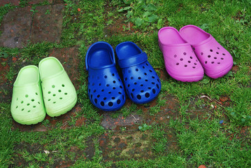 three pairs of rubber slippers