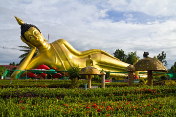 Reclining Buddha statue in temple's garden