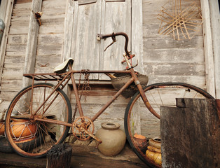 Old Bicycle and old wood house