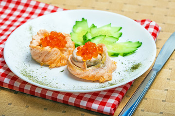 Appetizing of salmon fish with red caviar