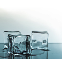 Ice cubes over color background