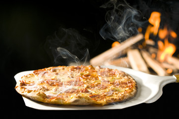 italian pizza baked in fire oven