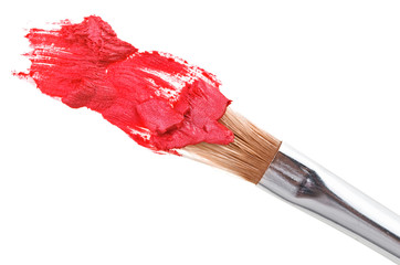 Red lipstick stroke (sample) with makeup brush, isolated on whit