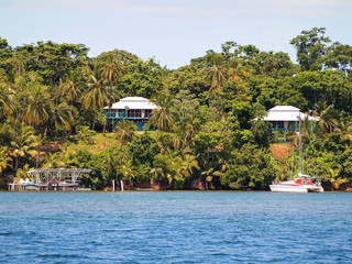 Caribbean coast with tropical house and lush vegetation, archipelago of Bocas del Toro, Panama, Central America