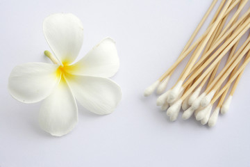 Cotton swab used for cleaning ear and Tropical flowers isolated