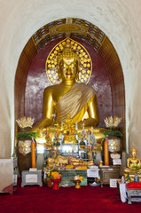 Golden Buddha in arch.