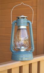 Retro oil kerosene lantern on country house fence closeup