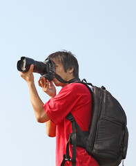 asian man taking photo