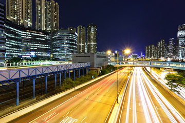 Urban city with traffic at night in Hong Kong