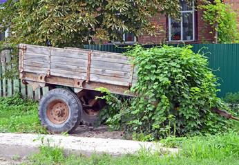 Ancient wooden cart standing on a green grass