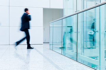 blurred businessman walking by