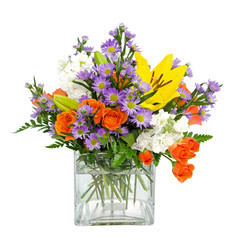 Colorful flower arrangement centerpiece in square glass vase