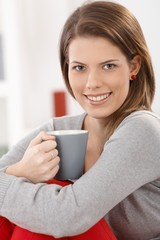 Cheerful woman with coffee cup