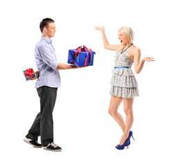 Male giving a gift to his excited girlfriend