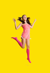 Beauty woman like girl jump on yellow
