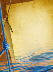 Marine ropes with sea knot on nautical  textured background