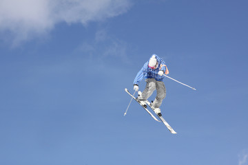 flying skier on mountains, in the sky