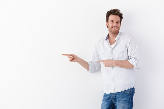 Happy man pointing to right