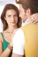 Beautiful woman hugging man