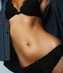 Tanned beautiful torso of athletic woman